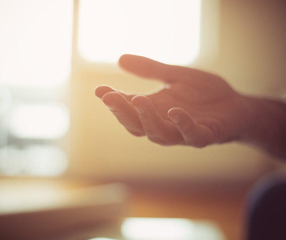 Caucasian hand reaching out for help. Indoor photo with sunlight coming through windows. Image by Mladen Zivkovic (iStock). Image used for faceyourfears.ca blog post Fear of Asking for Help: Not Wanting to Impose.