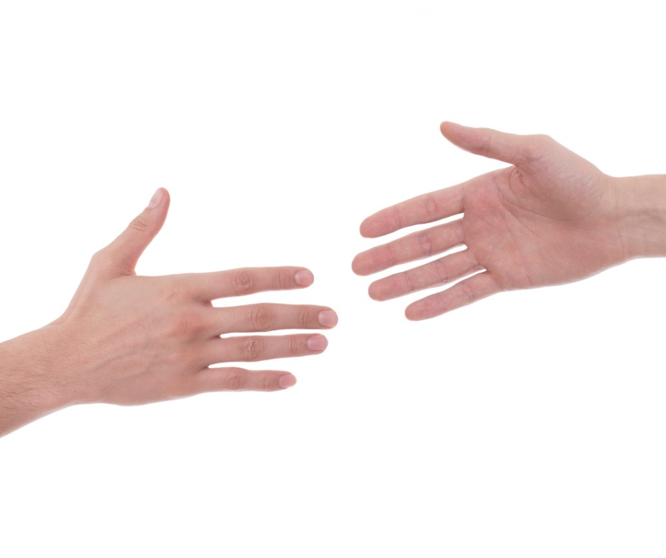 White male hands reaching for each other implying asking and providing help. White background. Image by reklamlar (iStock).